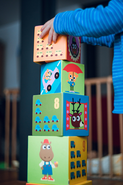 toddler playing building blocks